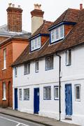 Row of old English terraced houses in Winchester, Hampshire, UK Stock Photos