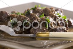 Venison goulash with red wine Stock Photos