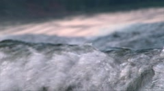 Close up water wave splashing with jumping wakeboarder Stock Footage