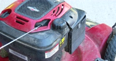 Pouring Gas into Push Lawn Mower - 4k Stock Footage