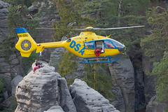 Rescue helicopter coming to Prachov Rocks nature area to rescue the injured Stock Photos