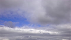 Gray clouds swimming on  background  of  blu  sky. Autumn cloudy day. Stock Footage