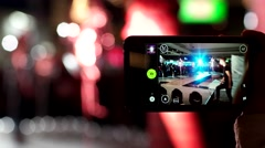 Mobile phone shoots video, showing men's clothing and shoes, the guys on the Stock Footage