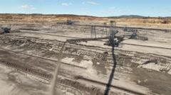 Aerial shot of bucket wheel excavator in open mine Stock Footage