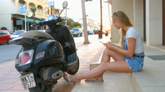 Girl makes a photo on Greek Street. Crete. 4K 30fps ProRes (HQ) Stock Footage