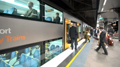 People boarding double-decker train in Sydney, Australia Stock Footage