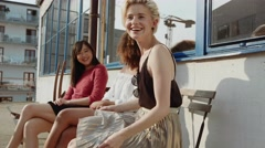 Group of women sitting outdoor and gossiping. Stock Footage