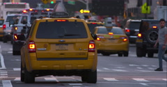 Taxi and pedestrian traffic at dusk on a busy New York City street Stock Footage