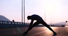 Runner takes a break on highway road Stock Footage