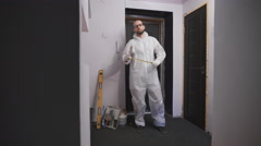 Professional work molar in a white protective suit, ready to begin the repair Stock Footage