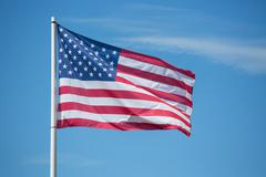American flag Stars and Stripes blowing in the wind Stock Photos