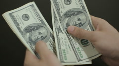 View of a man Counting Many American Dollar 100 bills. Stock Footage