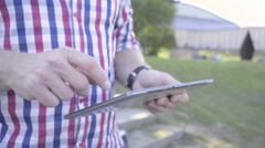 Close up on man's hands browsing tablet. Slider shot. Stock Footage