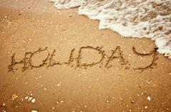 Holiday on summer beach sand Stock Photos