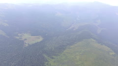 Flying over mountain forest in the mist Stock Footage