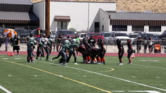Nice pass but the football is intercepted by defense in youth football game 3564 Stock Footage