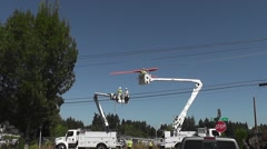Three Linemen Remove Insulator Covers From Wires Stock Footage