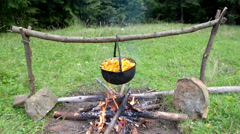 Cauldron with boiling mushrooms on the fire Stock Footage