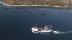 Aerial view of fish farm with cargo ship - Adriatic sea, Croatia Stock Footage