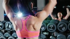 Self-confident athletic woman is engaged in a sports hall. Trains with a Stock Footage
