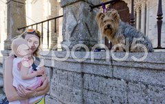 Mother with her baby girl looking at a dog Stock Photos