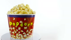 Salt popcorn in box on white background, rotation, full size Stock Footage