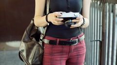 Punk girl holding old camera and browsing photos on it Arkistovideo