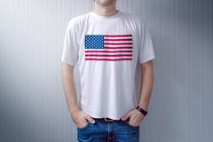 American patriot wearing white shirt with USA flag print Stock Photos