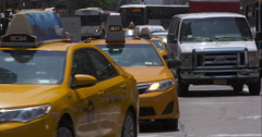 Oncoming New York City traffic on a hot summer day in slow motion Stock Footage