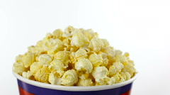 Salt popcorn in box on white background, rotation, close up Stock Footage
