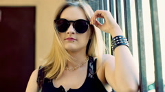 Punk girl wearing stylish sunglasses and looking to the camera Stock Footage