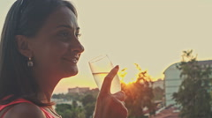 Elegant woman sipping champagne. Slow motion Stock Footage
