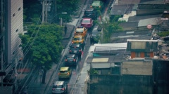 Cars Passing Slums On Rainy Day Stock Footage