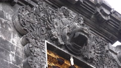 4k Bat temple-watcher sculpture close up tilt down Goa Lawah Bali Stock Footage