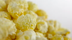 Salt popcorn in box on white background, rotation, very close up Stock Footage