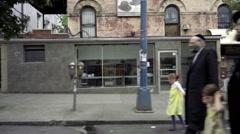 Hasidic Jews walking in street in Williamsburg Brooklyn, NYC Stock Footage