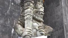 4k Bat temple-watcher sculpture close up tilt up Goa Lawah Bali Stock Footage