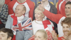 4K Mature woman with British flag in sports crowd disappointed by the team Stock Footage