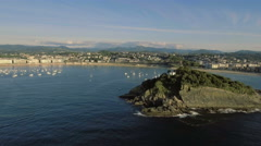 Aerial view of San Sebastian Bay and Santa Clara Island, Spain Stock Footage