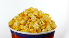 Cheese popcorn in box on white background, rotation close up Stock Footage