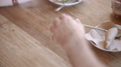 Portrait of a man and a girl's hand. Wood table in cafe. Man lays down his hand Stock Footage
