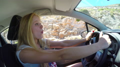 Beautiful girl driving car singing like crazy. 4K 30fps ProRes (HQ) Stock Footage