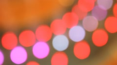 Bokeh of fountain lights with color effect reflected on water. Stock Footage