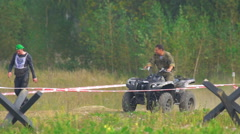 Russian army officer on quad bike Stock Footage