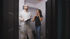 Worker and the customer to discuss the details of the construction of the repair Stock Footage