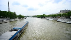 Passenger cruise boats with tourists on Seine river in Paris Stock Footage