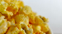 Cheese popcorn in box on white background, rotation, very close up Stock Footage