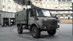 A military car near a railway station in Brussels, Belgium. Stock Footage