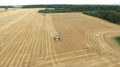 Aerial shot of combine harvester working  in a wheat field Stock Footage