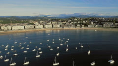 Flying Above the Boats towards San Sebastian Beach, Spain Stock Footage